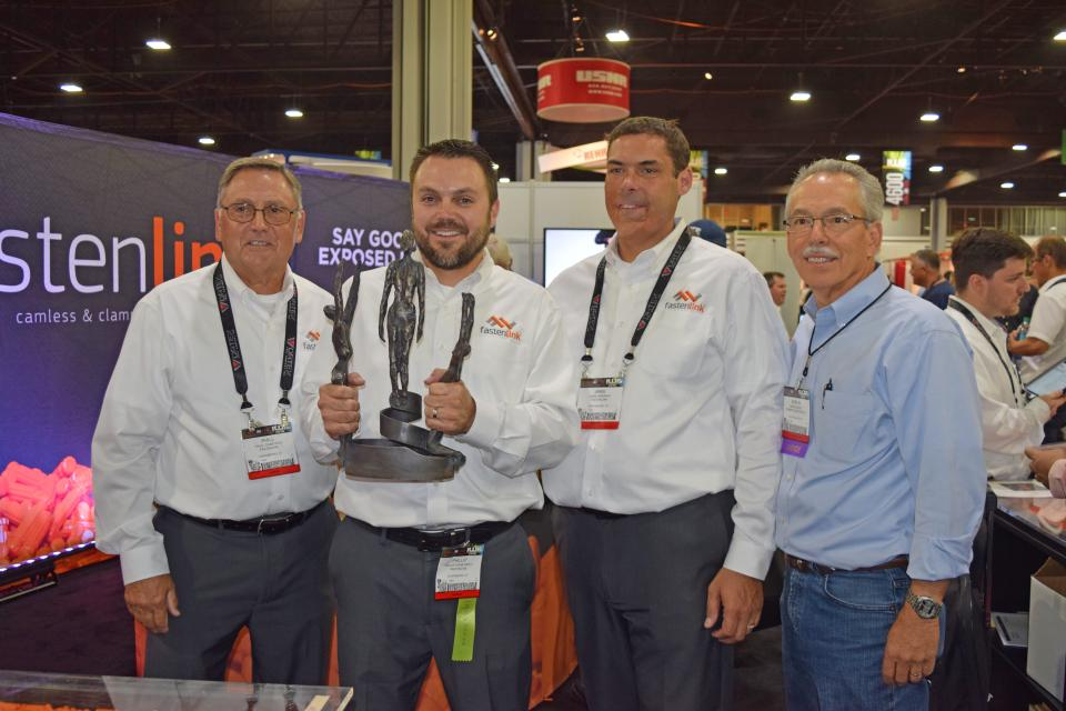 FastenLink won for its patent-pending fastening system. Pictured with the award are Phill Crabtree, Phillip Crabtree II, CEO/system developer and Jamie Mindrup, vice president of operations. The award was presented to them by judge Marlin Horst of Premier Custom Built.
